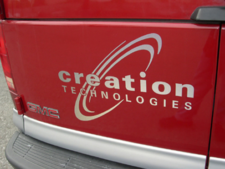 Creation Technologies red truck back